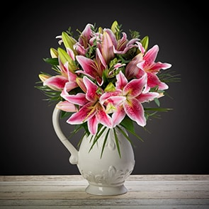 Pink Lily Delight Flowers Delivered - An elegant and timeless classic. Scented pink oriental lilies complimented by lush green foliage. This bouquet is perfect for any occasion and would brighten any room. 