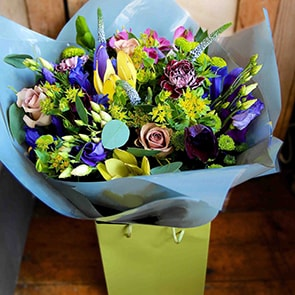 Poseidon Flowers Delivered - A flower arrangement in the shades of the seven seas: bright blues, muted lilacs and deep purple are set off by vivid lime green. These flowers are the perfect gift for any occasion.