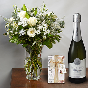 Prancer Gift Set Flowers Delivered - A combination of snowy whites and fresh greens will be an elegant addition to your household this holiday season. A bouquet that would even impress Mrs. Claus. Prancer is part of Bloom Magic's Christmas Collection. 