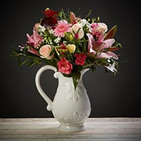Bloom Magic - Flower Delivery Ireland - A beautiful, gentle and feminine combination of powdery and hot pinks give this bouquet a special appeal. Perfect to celebrate a Baby girl's arrival or sweet as a romantic gesture. This bouquet features roses, lilies, lisianthus and gerbera, as well as gorgeous mix of seasonal bloom. This bouquet is available for flower delivery Dublin and flower delivery Ireland and satisfaction is alway guaranteed.