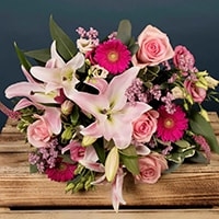 Bloom Magic - Flower Delivery Ireland - In honour of the Rose of Tralee flower festival in Kerry, our team of expert florists has created a gorgeous bouquet featuring large pink roses of the highest grade, mixed with wax-flowers and eucalyptus leaves. This bouquet comes expertly handtied by our experts and would look a treat in your favourite vase!