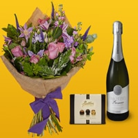 Bloom Magic - Flower Delivery Ireland - This suble and charming bouquet of flowerr, featuring pink roses, veronica and clematis is a perennial favourite with our customers. These flowers tell a love story: soft blues, muted lilacs and deep purples are beautifully combined by our expert florists.