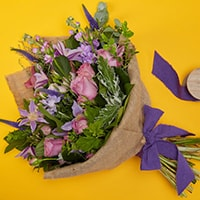 Bloom Magic - Flower Delivery United Kingdom - This suble and charming bouquet of flowerr, featuring pink roses, veronica and clematis is a perennial favourite with our customers. These flowers tell a love story: soft blues, muted lilacs and deep purples are beautifully combined by our expert florists.