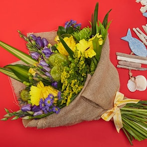 Bloom Magic - Flower Delivery Ireland - A wonderful bouquet of yellow roses, yellow gerbera and purple september flowers. Featuring exotic greenery and beautifully hand-tied, this is sure to please. Flower delivery available anywhere in Ireland. Same day flower delivery to Dublin