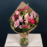 A wonderful bouquet of pink roses and pink lilies presented in an artistic hessian wrap. This bouquet of flowers is available for same-day delivery in Dublin and next day delivery anywhere in Ireland.   Valentines is very busy and supplies of each product are limited. Order early to avoid disappointment.   Vase is not included.