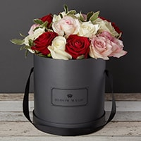 Bloom Magic - Flower Delivery Ireland - A vibrant bouquet containing a mixture of red and white roses. This flower arrangment comes in either a charcoal grey, or powder blue hatbox, and is perfect for any occasion. Same day flower delivery is available to Dublin and next day delivery is available to all of Ireland.