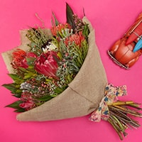 Bloom Magic - Flower Delivery Ireland - A unique bouquet of proteas, nutans and kaaps green. This bouquet will brighten any day and is sure to put a smile on the recipient's face. A perfect gift of birthday flowers or thank-you flowers. Flower delivery Ireland is available for order now.