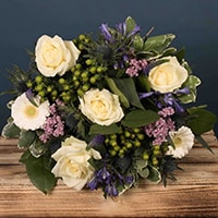 Bloom Magic - Flower Delivery Ireland - A gorgeous hand-tied bouquet featuring pink lillies, pink roses and pink chrysanthemums. This bouquet smells lovely and would be the perfect gift for a new baby or as a romantic gesture.
