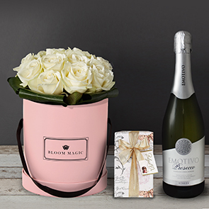 Une Nuit À Montmartre Gift Set Flowers Delivered - Une Nuit À Montmartre is a beautiful selection of top quality white avalanche roses that comes in a blush pink, charcoal grey or powder blue hat box. This is a beautiful and classy flower arrangement would make a perfect gift for any loved one. It's can be romantic or just classically elegant, so whatever the occasion this is the perfect bouquet to put a smile on their face.  This gift set comes with a bottle of Italian prosecco and a box of 175g gift wrapped Belgian chocolates