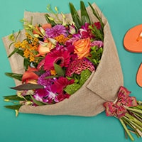 Bloom Magic - Flower Delivery  United Kingdom - A fun and carefree bouquet of orange roses, pink calla lillies and pink orchids. These flowers will be sure to pleaes for any occasion, whether a birthday or a thank-you gift.