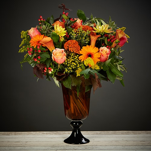 Bloom Magic - Flower Delivery Ireland - A gorgeous mix of warm autumn colours. A striking and vibrant bouquet featuring roses, gerber, calla lillies and hypericum. These flowers are a perfect gift for birthday flowers, anniversary flowers or even as a thank-you gift. Our team of florists is expert at choosing the freshest and most seasonal blooms for your bouquet. Order now for same-day flower delivery Dublin and next day Flower delivery to all of Ireland.