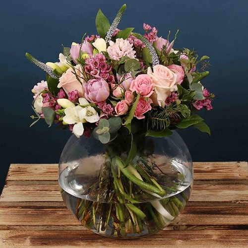 A beautiful Mother's Day Posie made up of a combination of pink flowers. The beautiful bright flowers that make up this arrangement would make it look amazing in any home.  We offer flower delivery Dublin.