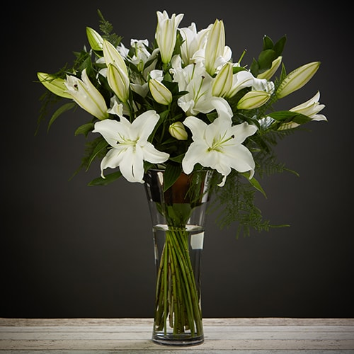 Bloom Magic - Flower Delivery Ireland - An elegant and timeless classic. Scented oriental lilies complimented by lush green foliage. By special request, you can choose from either pink or white lillies. This flower arrangement is designed by the countries top florists. Available for same day delivery in Dubln and next day delivery nationwide.