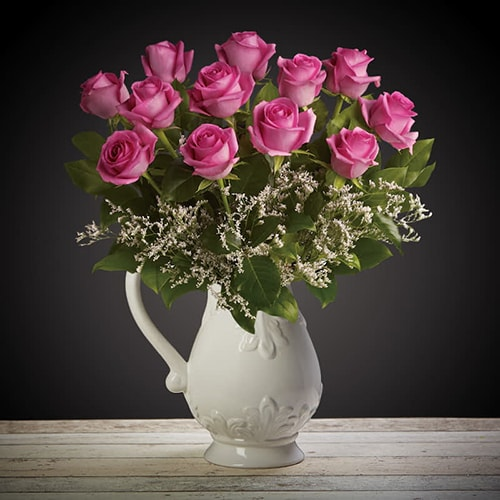 Bloom Magic - Flower Delivery Ireland - What's more special than receiving the classic gift of one dozen luxurious pink roses? Long stemmed Grade A pink roses, expertly hand-tied and giftwrapped to make sure that someone special feels amazing. These romantic flowers would look amazing in any home.