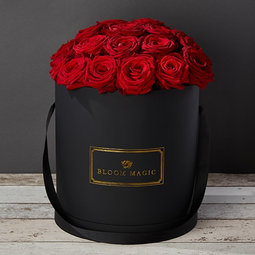 Bloom Magic - Flower Delivery Ireland - This hatbox flower arrangement features stunning red roses immaculately arrange and presented in a choice of either a matte black or pearl white large hatbox. this arrangement is the perfect gift, especially if you are looking for some Valentines flowers to make that someone special feel amazing. We offer same day delivery for this arrangement to anywhere in Dublin, and next day delivery to anywhere in Ireland.