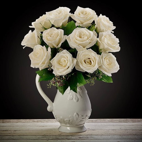 Bloom Magic - Flower Delivery United Kingdom - What's more special than receiving the classic gift of one dozen luxurious white roses? Long stemmed Grade A roses are perfectly suitable for birthday flowers, romantic flowers, engagement flowers, or even just because.