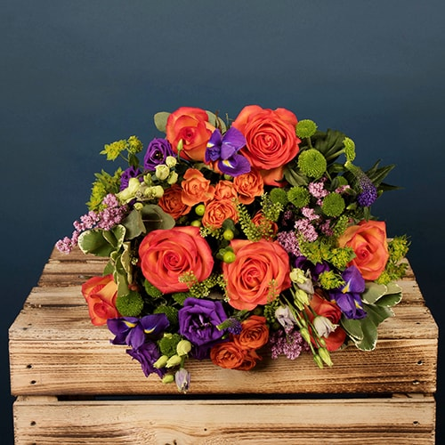 Bloom Magic - Flower Delivery Ireland - A lovely orange and purple bouquet featuring mango cala and mini gerbera. These flowers are classic and timeless and can be sent for any occasion. This tasteful arrangement is available for same-day delivery in Dublin and next-day flower delivery to all of Ireland.