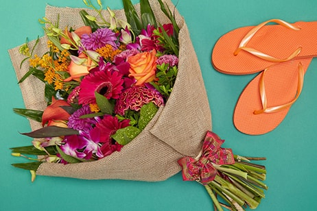 Bloom Magic - Flower Delivery Ireland - A fun and carefree bouquet of orange roses, pink calla lillies and pink orchids. These flowers will be sure to pleaes for any occasion, whether a birthday or a thank-you gift. Flower delivery to Dublin is available same-day.