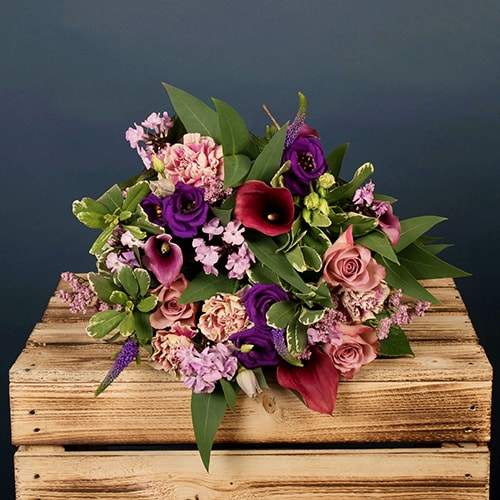 Bloom Magic - Flower Delivery Dublin - A lavish bouquet of flowers, filled with vibrant calla lily's, pink roses and purple roses. This bouquet comes expertly hand-tied with luxurious eucalyptus leaves. This bouquet is sure to put a smile on their face!