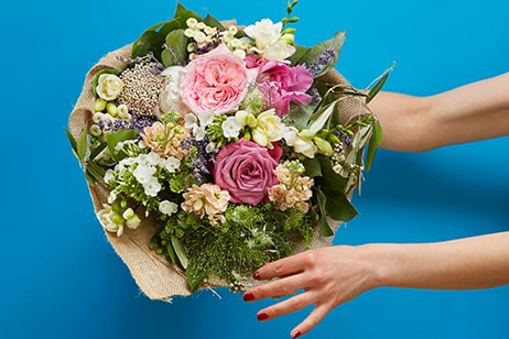 Bouquet of roses, freesia and herbs