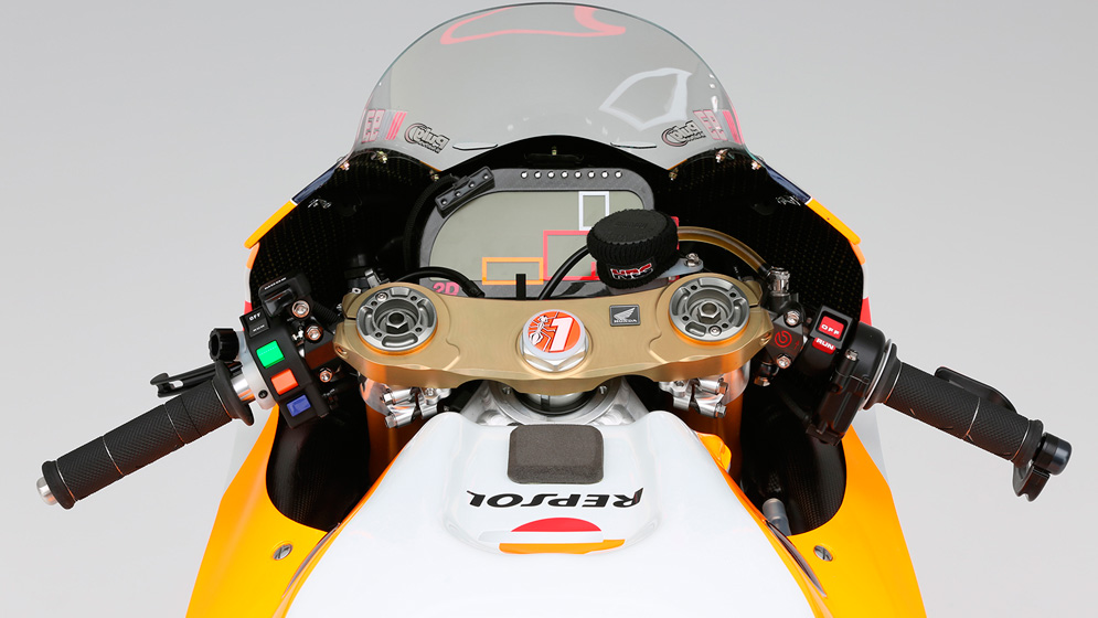 What are the buttons on a MotoGP bike for?