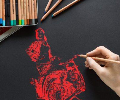 la mano de una artista motera dibuja una ilustración sobre motos