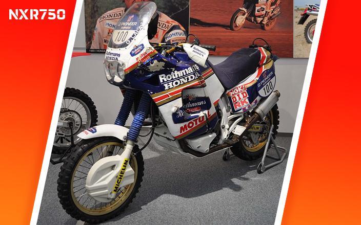 Nxr750 de Edi Orioli aparcada en una exposiciuón, moto con la que Edi Orioli ganó el Dakar