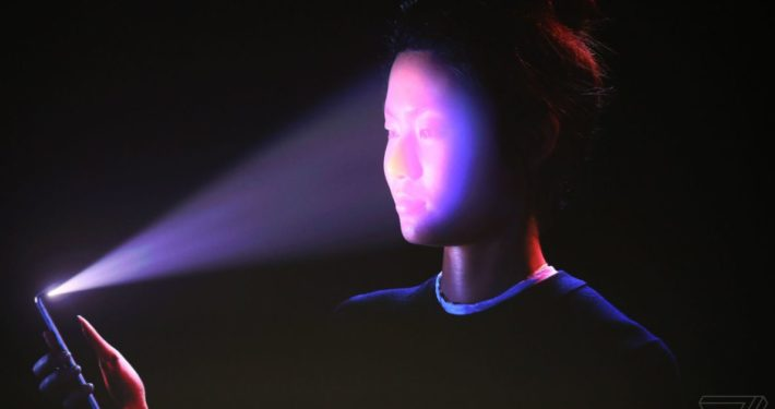 Person using iPhone X FaceID
