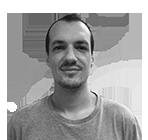 A black and white photo of Carlos Rivas.