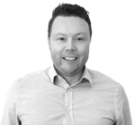 A black and white photograph of Sean, Head of Finance at Rapid Formations.