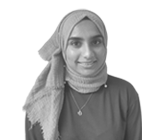 A black and white photograph of Zafirah, a Compliance Executive at Rapid Formations.