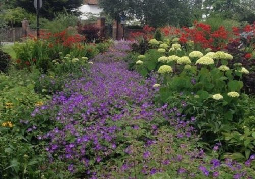 River of Flowers Gets A Tidy Ahead of Judging for Britain in Bloom