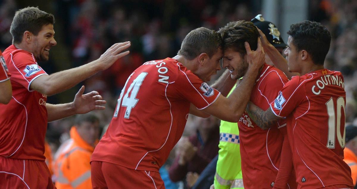 Liverpool-players-congratulate-Adam-Lallana