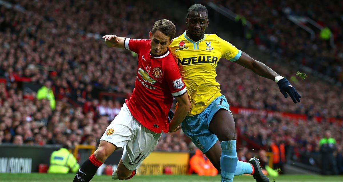 Adnan Januzaj takes elusive action with Crystal Palace's Yannick Bolasie giving chase
