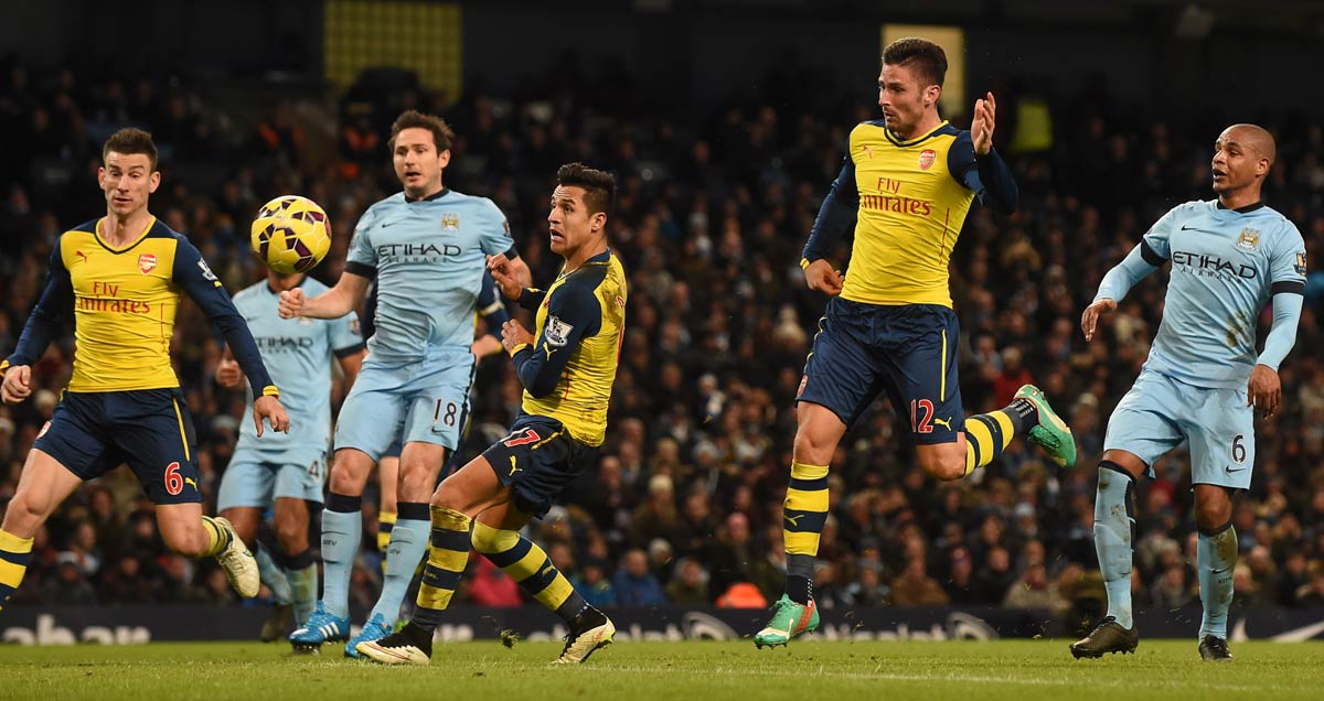 Arsenal's-Olivier-Giroud-heads-in-against-Man-City-