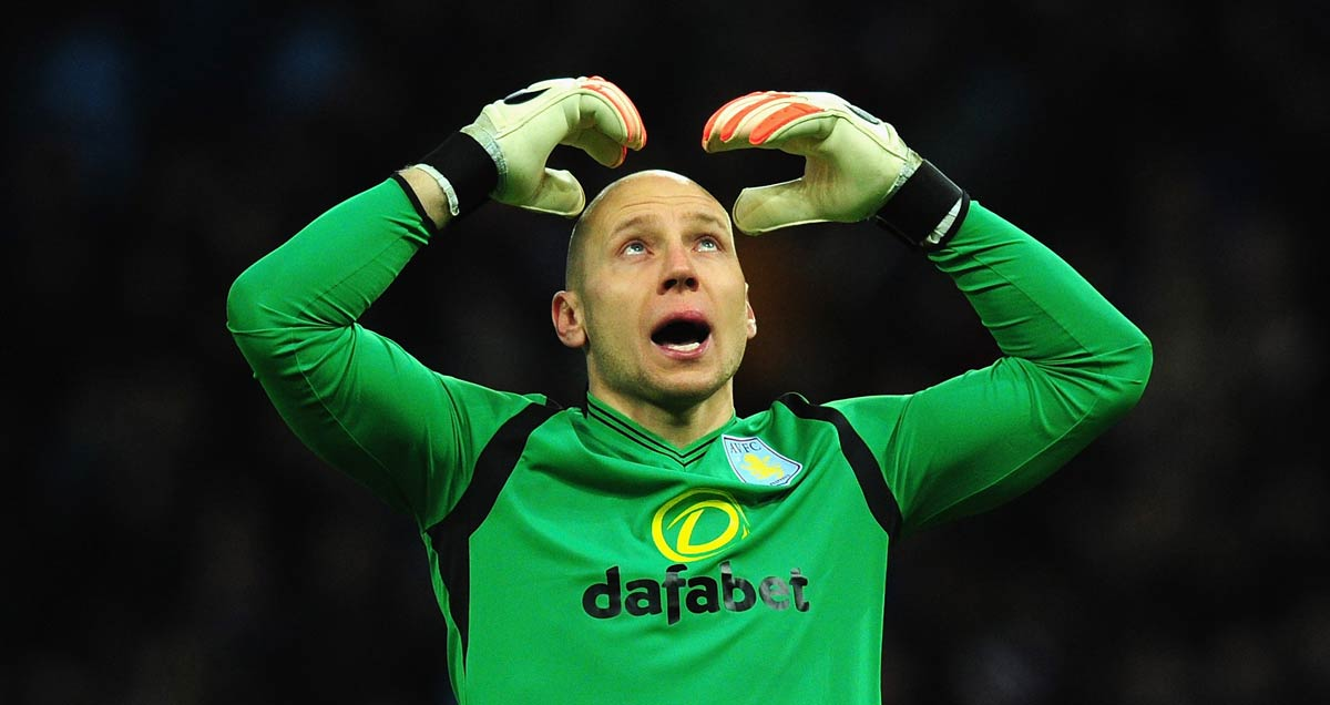 Aston-Villa's-Brad-Guzan-attempts-a-'Mobot'-to-stifle-the-boredom