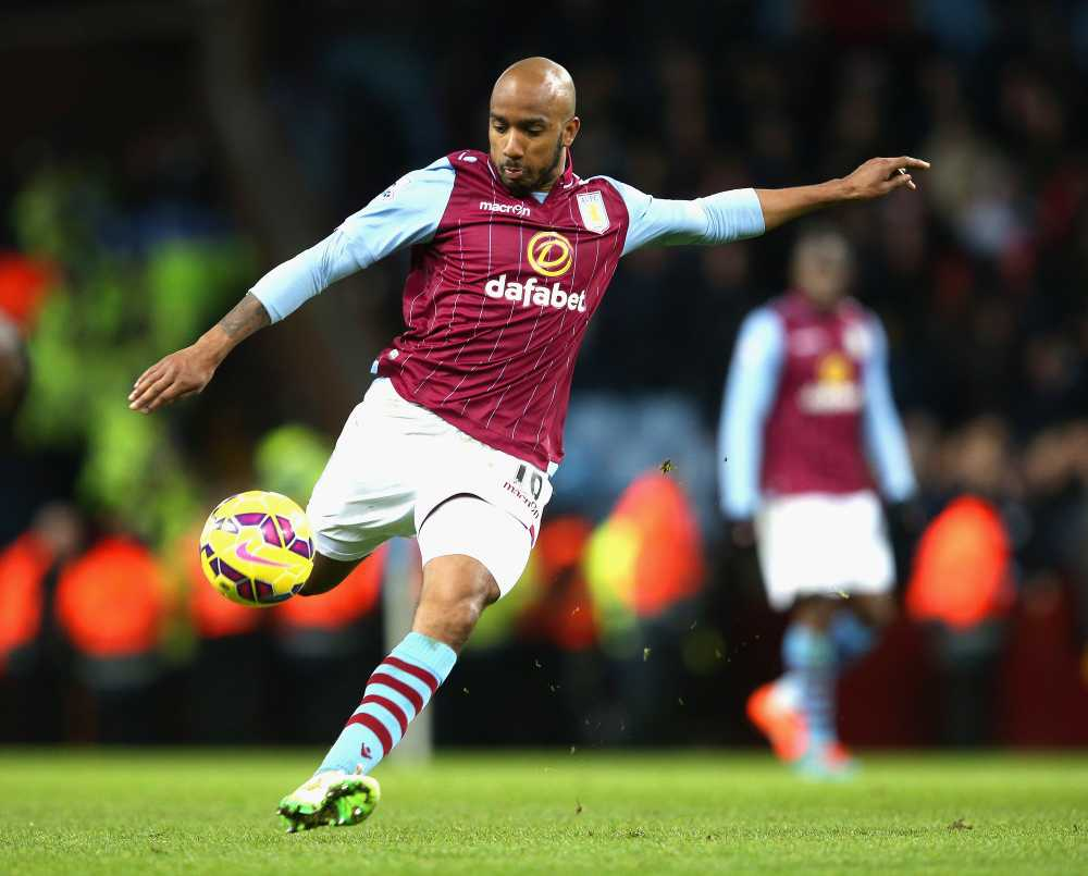 Aston Villa's Fabian Delph lines up a shot