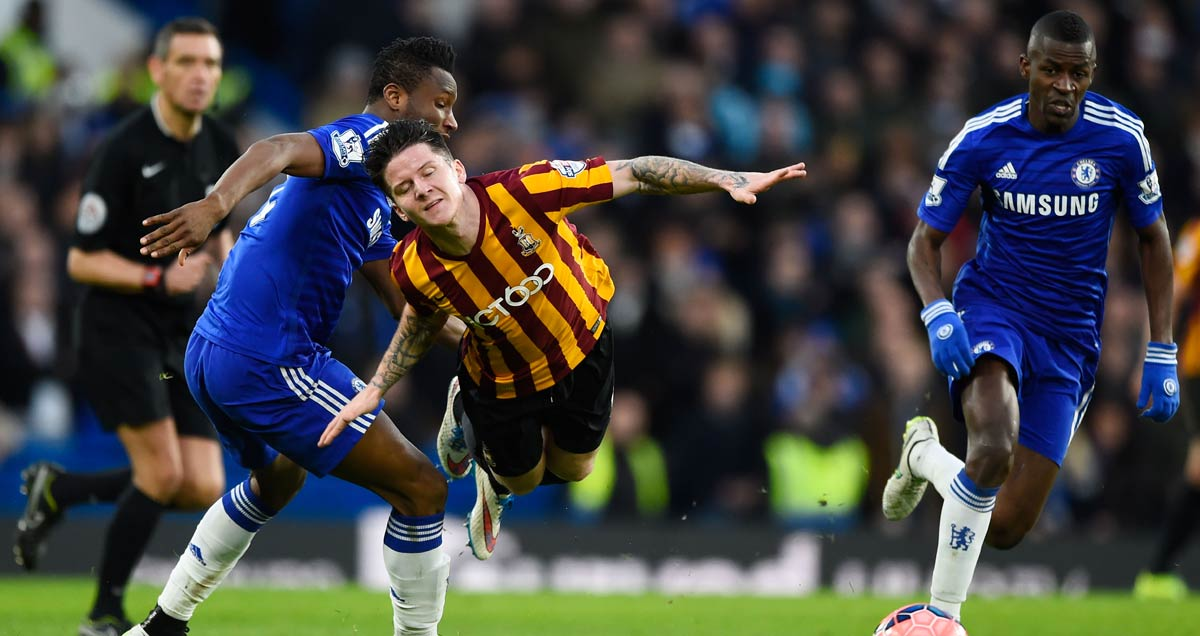 Chelsea's John Obi Mikel upends Bradford's Billy Knott as Ramires looks on