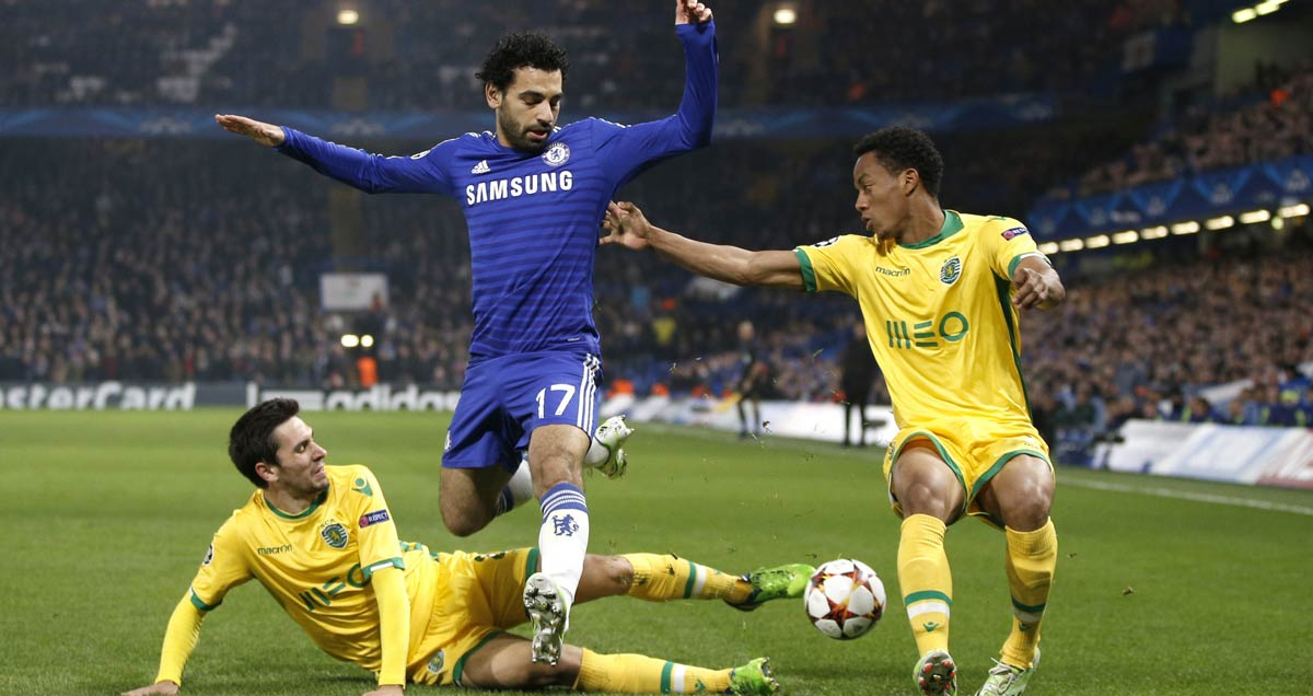 Chelsea's-Mohamed-Salah-vies-with-two-Sporting-defenders