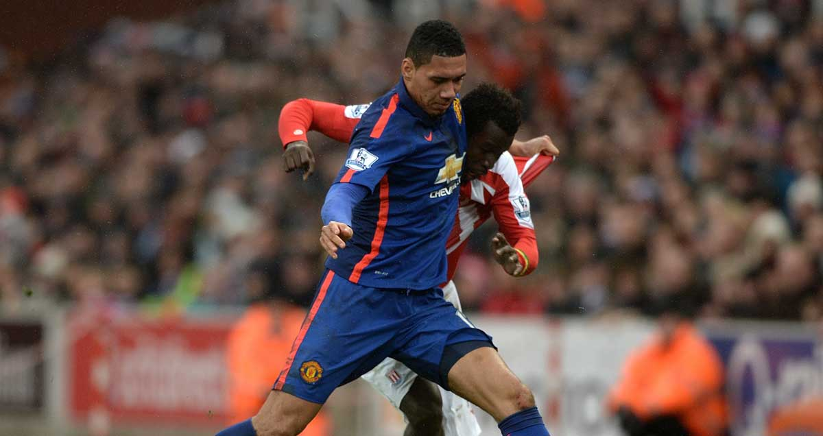 Man Utd's Chris Smalling tussles with Mame Diouf of Stoke