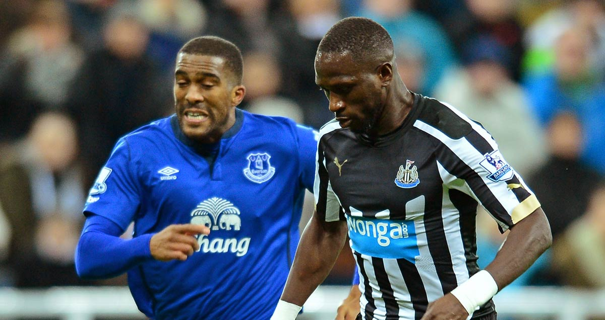 Everton's Sylvain Distin vainly tries to chase down Moussa Sissoko of Newcastle