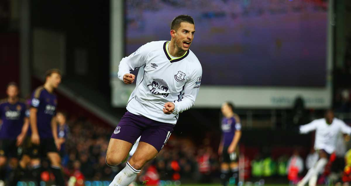 Kevin Mirallas wheels away in celebration