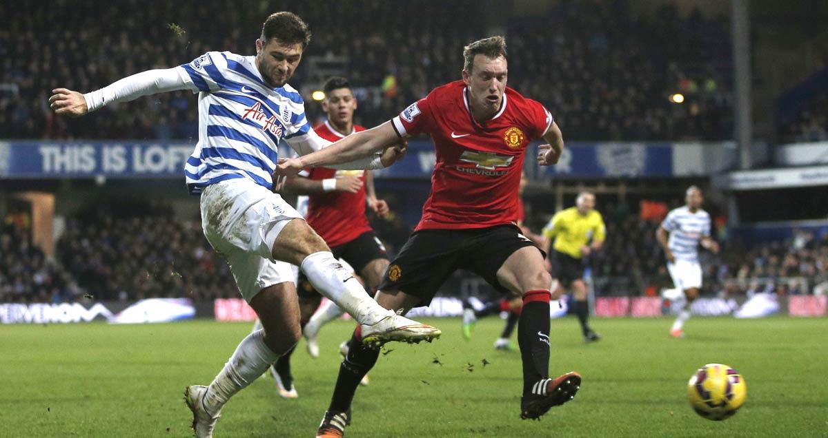 Man Utd's Phil Jones closes down QPR's Charlie Austin