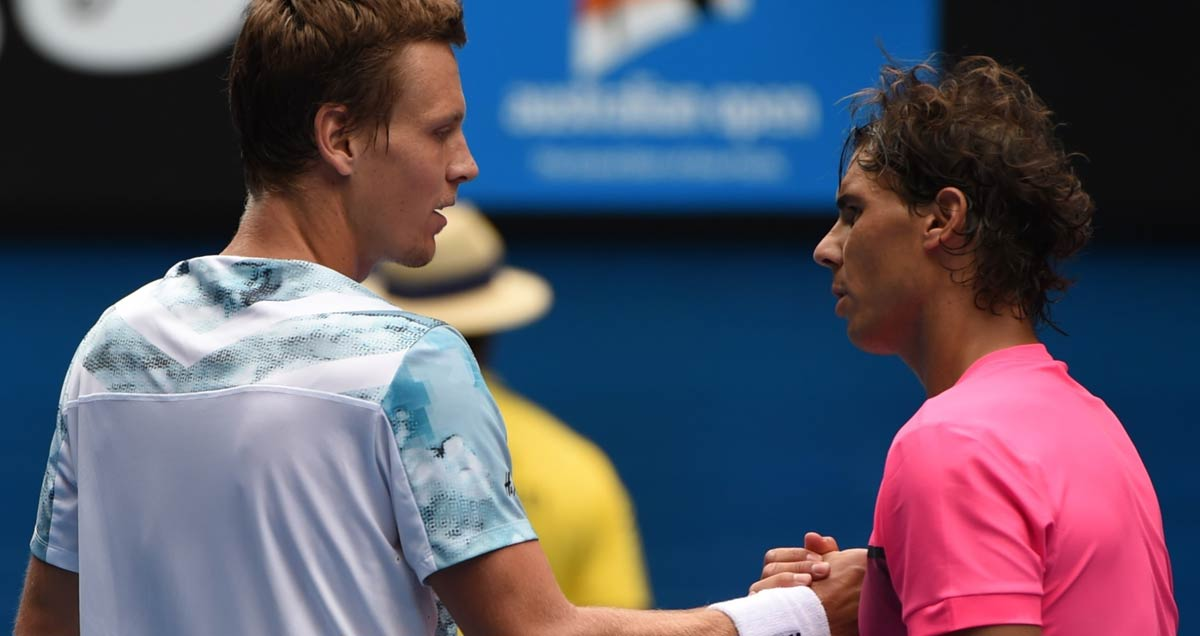 Tomas Berdych shakes hands with the vanquished Rafael Nadal