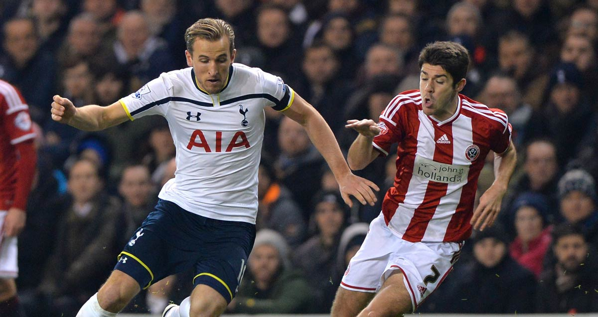 Tottenham's-Harry-Kane-gildes-past-Sheff-Utd's-Ryan-Flynn