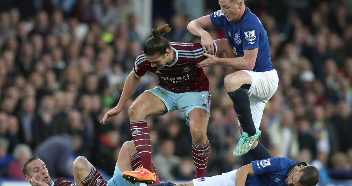 West Ham players Kevin Nolan and Andy Carroll in tag-team action against James McCarthy and Leon Osman of Everton