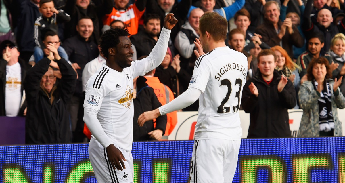 Wilfried Bony and Gylfi Sigurdsson celebrate a Swansea goal