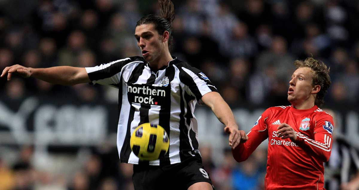 Andy Carroll holding off future teammate Lucas Levia in his Newcastle days