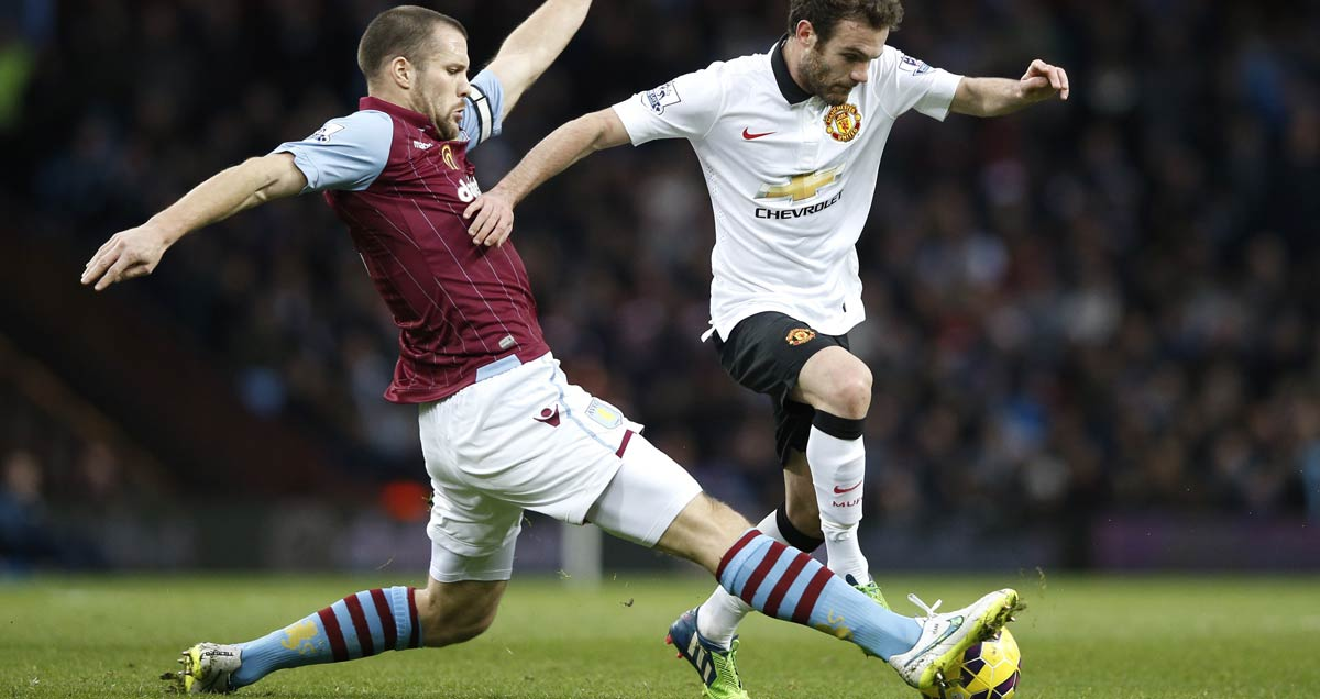 Aston Villa captain Ron Vlaar closes down Juan Mata of Man Utd