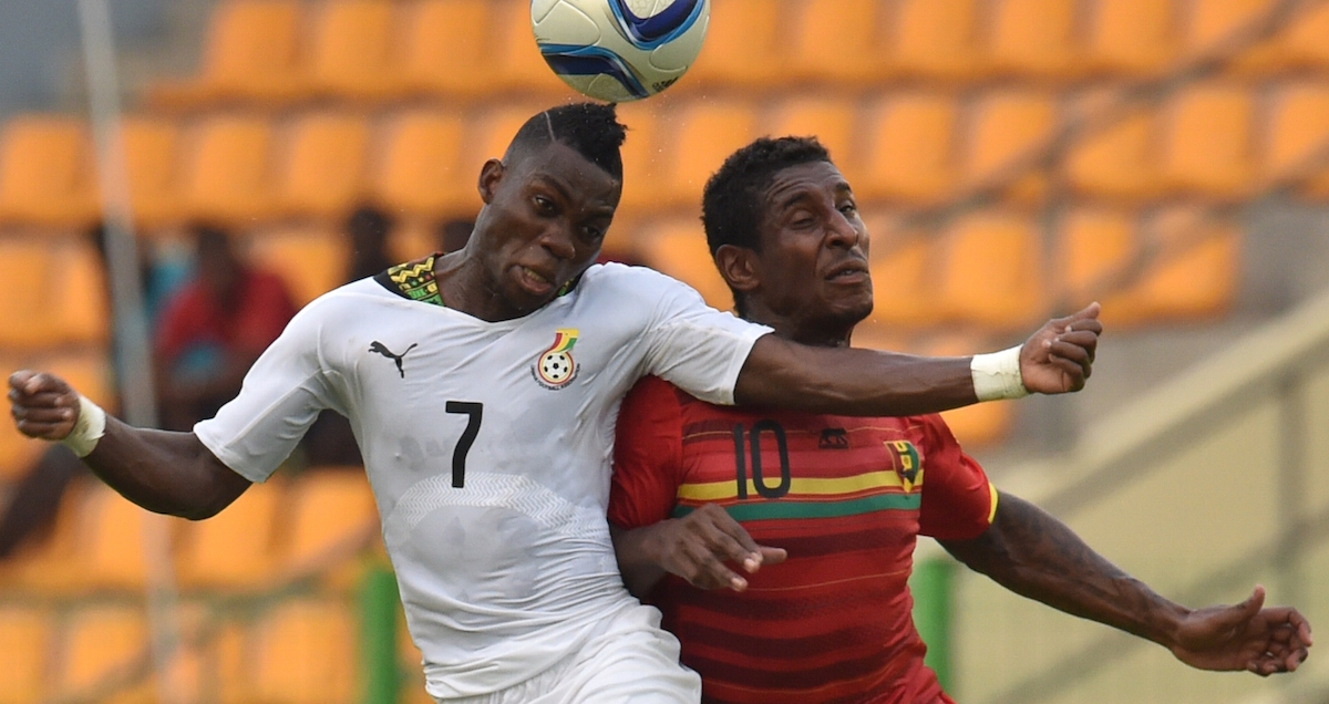 Ghana's Christian Atsu (L) vies with Guinea's Kevin Constant (R) during the 2015 African Cup of Nations quarter-final football match between Ghana and Guinea in Malabo